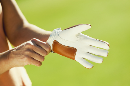 Italy,Kastelruth,Mid Adult Woman Wearing Golf Glove