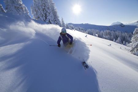 Austria,Tyrol,Kitzbuehel,Young Woman Skiing