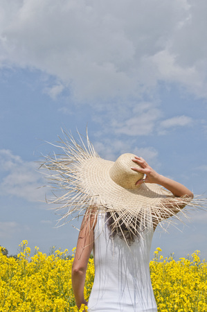 Germany,Woman With Straw Hat Standing In Field