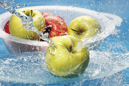 Fresh Apples In Colander Washing Under Water