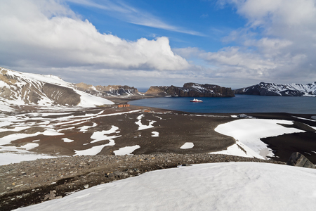 South Atlantic Ocean,Antarctica,Antarctic Peninsula,South Shetland,Deception Island,Whalers Bay,Deserted Hektor Whaling Station And Polar Star Icebreaker Cruise Ship At Distant LANG_EVOIMAGES