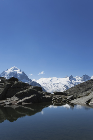 Europe,Switzerland,Grisons,Upper Engadin Alps,South Engadin Alps,View Of Bernina Mountain Peaks At Fuorcla Surley Lake