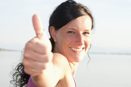 Mid Adult Woman Showing Thumbs Up Sign,Portrait