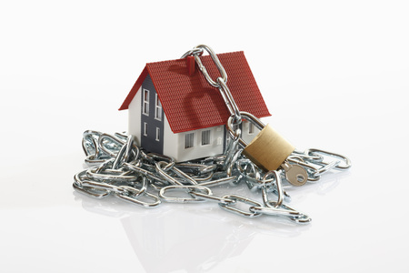Model House Locked With Chain And Padlock On White Background LANG_EVOIMAGES