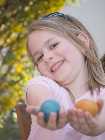 Germany,Bavaria,Close Up Of Girl Joking With Easter Eggs,Smiling,Portrait LANG_EVOIMAGES