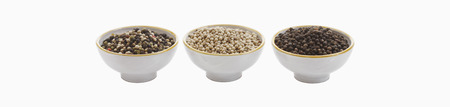 Variety Of Peppercorns In Bowl Against White Background,Close Up LANG_EVOIMAGES