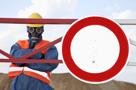 Germany,Man In Protective Workwear Near Stop Sign LANG_EVOIMAGES