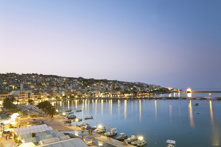Greece,Crete,Sitia,View Of City With Harbor At Dusk LANG_EVOIMAGES