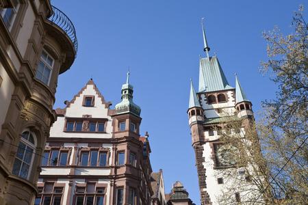 Deutschland,Baden-Wurttemberg,Black Forest,Freiburg Im Breisgau,Kaiser-Joseph-Strasse,View Of Martinstor Building With Houses And Old City Gate