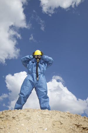 Germany,Bavaria,Man In Protective Workwear Standing On Top Of Sand Dune