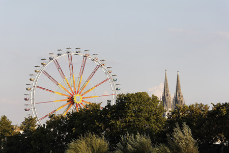 Germany,Bavaria,Upper Palatinate,Regensburg,View Of Ferris Wheel With Cathedral LANG_EVOIMAGES