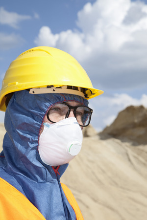 Germany,Bavaria,Man In Protective Workwear At Sand Dune