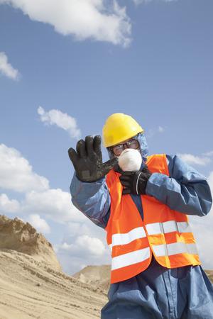 Germany,Bavaria,Man In Protective Workwear Near Sand Dune