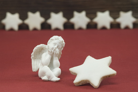 Putto Beside Star Shaped Cinnamon Cookies