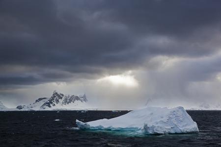 South Atlantic Ocean,Antarctica,Antarctic Peninsula,Gerlache Strait,Iceberg With Snow-Covered Mountain Range At Dawn