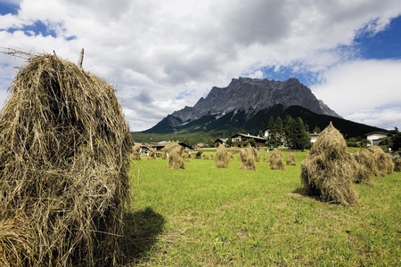 Austria,Tyrol,Zugspitz,View Of Haystacks With Mountains In Background