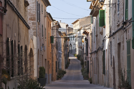 Spain,Balearic Islands,Majorca,Carrer De La Roca,View Of Old Town Of Alcudia LANG_EVOIMAGES