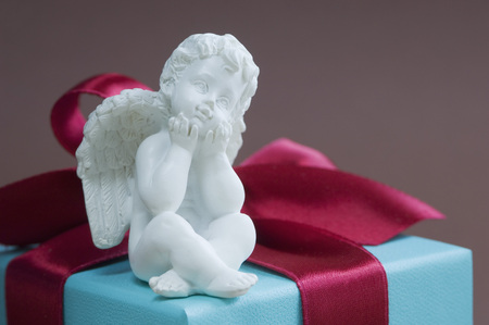Putto On Gift Box Tied With Red Ribbon LANG_EVOIMAGES