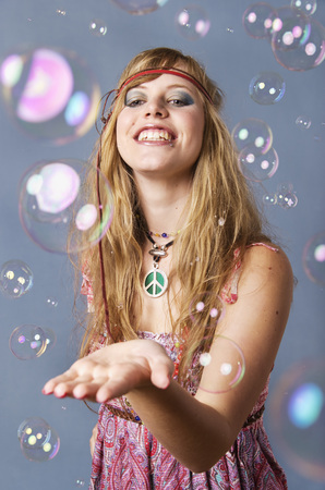 Young Hippie Woman With Bubbles Against Grey Background,Smiling