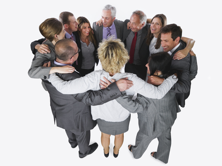 Business People Forming Huddle Against White Background LANG_EVOIMAGES