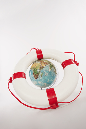 Lifesaver And Globe Against White Background LANG_EVOIMAGES