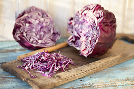 Close Up Of Sliced With Whole Red Cabbage On Grater