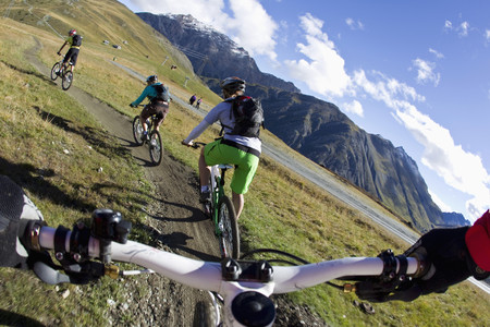 Italy,Livigno,View Of Woman And Man Riding Mountain Bike Downhill
