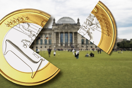 Germany,Berlin,One Euro Coin With Quarter Piece In Front Of German Bundestag Building