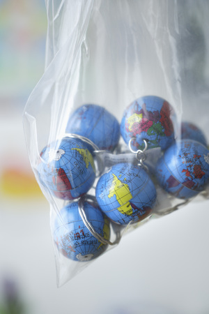 Europe,Germany,Close Up Of Earth Globes In Plastic Bag LANG_EVOIMAGES