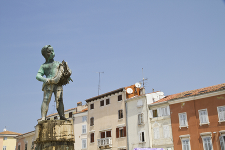 Croatia,Istria,Rovinj,View Of Statue In Front Of Buildings LANG_EVOIMAGES