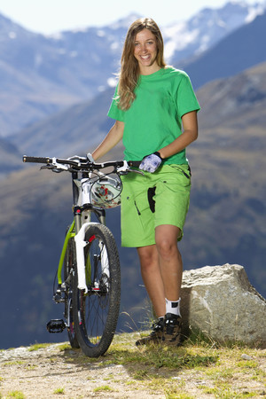 Italy,Livigno,View Of Woman Standing With Mountain Bike