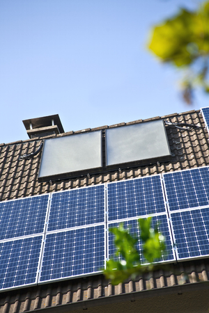 Germany,Cologne, House Rooftops With Different Of Solar Panels