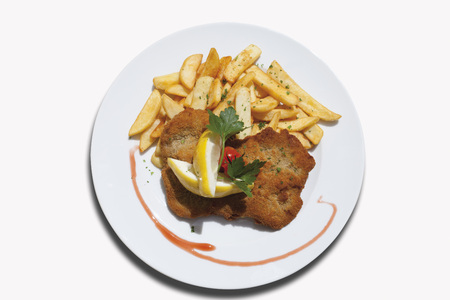Close Up Of Viennese Schnitzel With French Fried Potatoes Against White Background LANG_EVOIMAGES