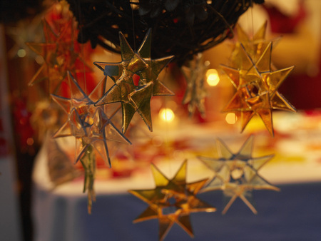 Germany,Bavaria,Close Up Of Christmas Stars And Christmas Market In Winter