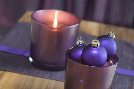 Close Up Of Christmas Bauble And Tealight Candle