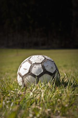Germany,North Rhine-Westphalia,D��Sseldorf,Close Up Of Old Football On Grass