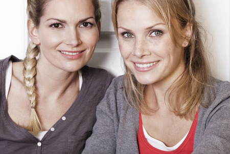 Italy,Tuscany,Magliano,Two Young Women In Kitchen,Smiling,Close Up,Portrait