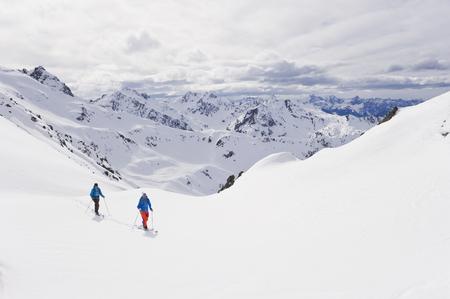 Austria,Stuben,Young Couple Doing Telemark Skiing On Arlberg Mountain