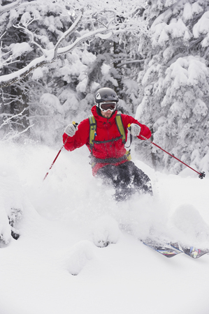 Germany,Bavaria,Young Man Doing Telemark Skiing In Herzogstand Mountain Forest