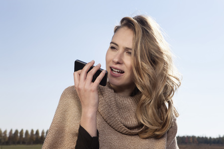 Germany,Bavaria,Munich,Young Woman On Cell Phone