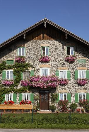Germany,Bavaria,Upper Bavaria,Rupertiwinkel Region,View Of Cottage LANG_EVOIMAGES
