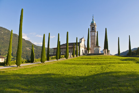 Switzerland,Ticino,Montagnola,View Of Church With Cypress LANG_EVOIMAGES