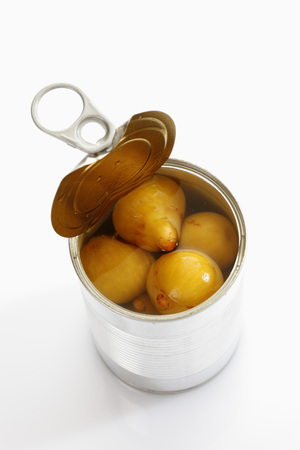 Preserved Fig In Tin Can On White Background