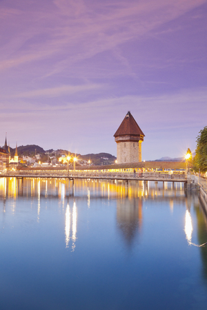 Switzerland,Lucerne,View Of Chapel Bridge With Water Tower And Old Town In Morning Light