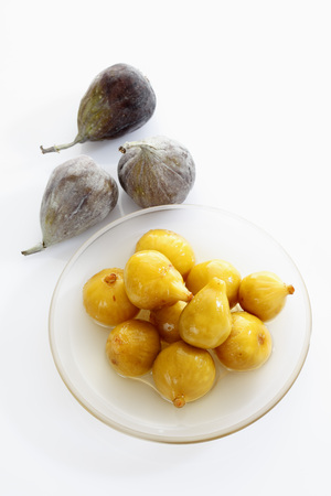 Preserved Fig In Plate On White Background