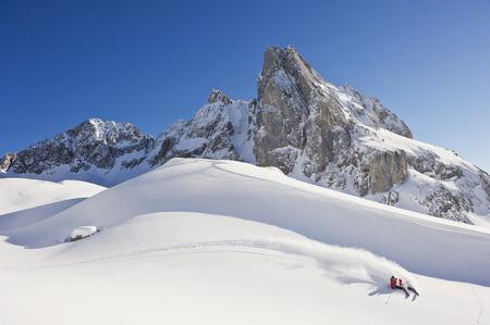 Austria,Zuers,Young Man Doing Telemark Skiing On Arlberg Mountain