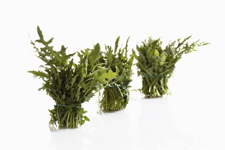 Three Bunches Of Rocket On White Background