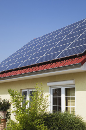 Germany,Cologne,Roof Of Residential Building With Solar Panels