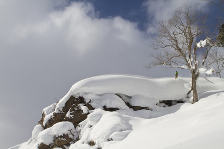 Japan,Hokkaido,Man Doing Telemark Skiing