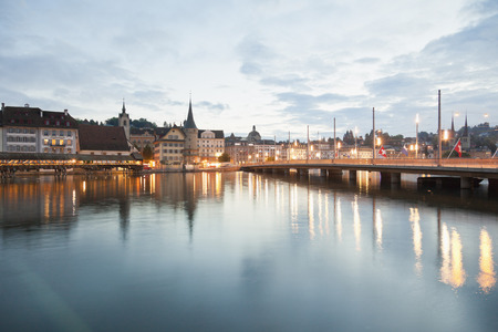 Switzerland,Lucerne,View Of Schweizerhofquai Bridge With Water Tower And Old Town In Morning Light LANG_EVOIMAGES